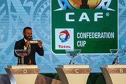 March 21, 2018 - Cairo, Egypt - Former Zamalek midfielder Hazem Emam assist CAF Deputy General Secretary Anthony Baffoe to conduct the draw on Wednesday, 21 March 2018 in Cairo, Egypt. (Credit Image: © Islam Safwat/NurPhoto via ZUMA Press)