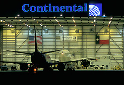 Continental Airlines Airplanes in Airplane Hanger with American Flag and Texas Flag
