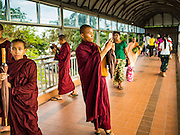21 OCTOBER 2015 - YANGON, MYANMAR: Buddhist novices in a pedestrian overpass that crosses Strand Road near the Dallah ferry pier in Yangon.    PHOTO BY JACK KURTZ