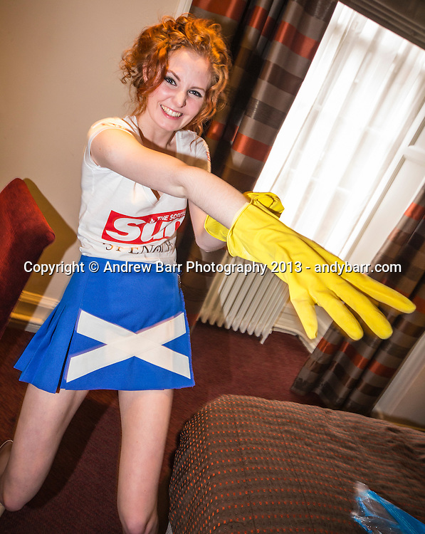 02:05:2013..Miss Scotland 2013 - chambermaid challenge at Grand Central Hotel...Rubber gloves with Laura P...Pic:Andy Barr..07974 923919  (mobile).andy_snap@mac.com..All pictures copyright Andrew Barr Photography. ..Please contact before any syndication. .