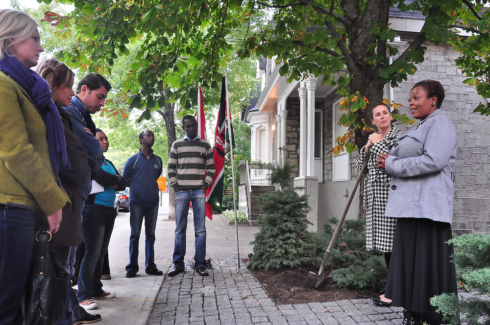The Sauve Scholars and friends plant a tree outside Sauve House in Montreal in memory of Dr Wangari Maathai on October 17th 2011. Dr Maathai passed away on September 25th, 2011. Flora Terah, a friend of Dr Maathai was in attendance.