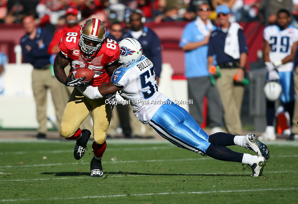 San Francisco 49ers tight end Vernon Davis (85) tries to avoid a diving tackle by Tennessee Titans diving linebacker Keith Bulluck (53) during the NFL football game against the Tennessee Titans, November 8, 2009 in San Francisco, California. The Titans won the game 34-27. (©Paul Anthony Spinelli)