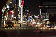 night view of Tokyo with pedestrian crossing