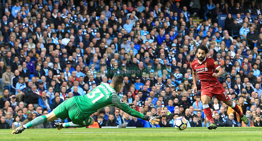 Liverpool's Mohamed Salah has an attempt on goal saved by Manchester City goalkeeper Ederson