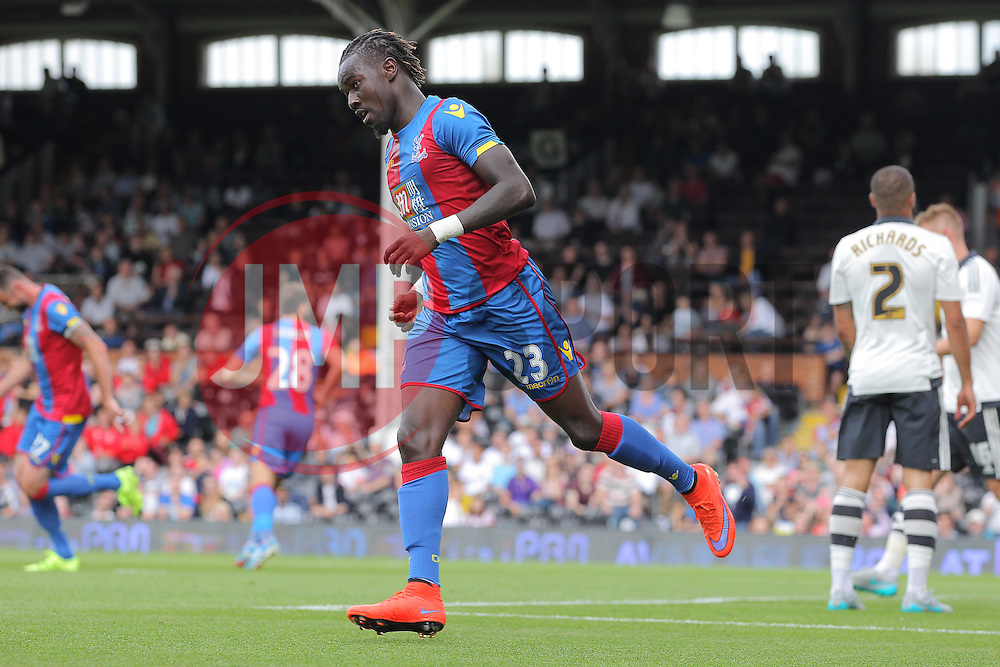 Pape Souare of Crystal Palace celebrates after he scores to make it 1-1 - Mandatory by-line: Paul Terry/JMP - 07966386802 - 01/08/2015 - SPORT - FOOTBALL - Fulham,England - Craven Cottage - Fulham v Crystal Palace - Pre-Season Friendly