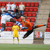 St Johnstone v Eskisehirspor...26.07.12  Europa League Qualifyer<br /> Gregory Tade scores his goal<br /> Picture by Graeme Hart.<br /> Copyright Perthshire Picture Agency<br /> Tel: 01738 623350  Mobile: 07990 594431