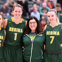 Caitlin Zacharias (15), Charlotte Kot(1), U of R President Dianne Timmons and Sara Hubenig(7) during the Women's Basketball home game on January 27 at Centre for Kinesiology, Health and Sport. Credit: Arthur Ward/Arthur Images