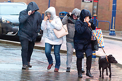© Licensed to London News Pictures. 14/01/2020. Porthcawl, Bridgend, Wales, UK. People battle against gale force winds in the small Welsh seaside resort of Porthcawl in Bridgend, UK. on the day following Storm Brendan's arrival on the south Welsh coastline, Photo credit: Graham M. Lawrence/LNP