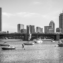 Boston Skyline black and white photo. Includes Longfellow Bridge, John Hancock Tower, Prudential Tower and boats along the Charles River. Boston Massachusetts is a major city in the Eastern United States of America.