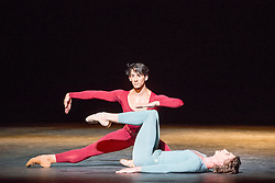 © Licensed to London News Pictures. 24/07/2013. English National Ballet's A Tribute To Rudolf Nureyev at the London Coliseum. Benois de la Danse winner Vadim Muntagirov performs in Song of a Wayfarer and Raymonda, Tamara Rojo in Raymonda and with Fabian Reimair in Petrushka. Picture shows Vadim Muntagirov and Esteban Berlanga in Song of a Wayfarer. Photo credit: Tony Nandi/LNP