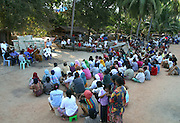 """Koh Lanta, Thailand--Esteemed Buddhist monk, Buddha Isara, addresses the villagers of Hua Laem after many of them lost their homes and fishing boats to the Tsunami on December 26th, 2004.  """"I know you are Muslims and I come to you not as a Monk but as a Thai,"""" said Isara who pledged to supply the materials and experienced labor needed to repair the village's fishing boats.  In addition, Isara plans to live in the village for several weeks, primarily to send a message to the Thai government of peaceful resistance to the relocation plans. Within Thailand, Isara is seen as a modern-day Gandhi figure, thus giving the villagers a powerful voice. 01/31/05 © Julia Cumes / The Image Works"""