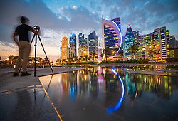Evening skyline view of West Bay business district in Doha, Qatar