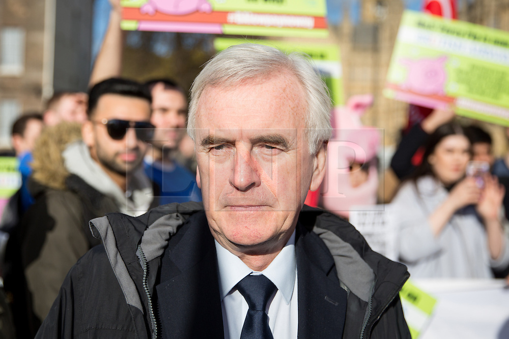 © Licensed to London News Pictures. 07/02/2017. London, UK. Shadow Chancellor of the Exchequer JOHN MCDONNELL (right) attends a demonstration by British Airways cabin crew. Striking cabin crew working for the airline's mixed fleet demonstrate with flags and placards outside parliament today, seeking MPs' support for a higher wage. Photo credit : Tom Nicholson/LNP