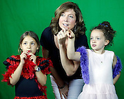 From left, Molly Heinzelman, 9, Wendy Mancarella and her daughter Lea Mancarella, 9, all of Pittsford, look at their picture at the Democrat and Chronicle's photo booth at the Xerox Rochester International Jazz Festival on Friday, June 20, 2014.
