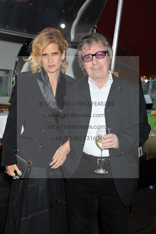 BILL WYMAN and his wife SUZANNE at the inaugural Gabrielle's Gala in London in aid of Gabrielle's Angel Foundation for Cancer Research held at Battersea Power Station, London on 7th June 2012.