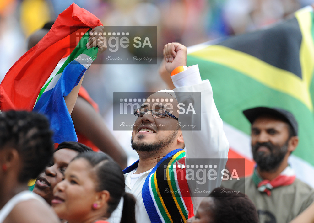 "A section of the crowd wave flags and hold posters aloft during the City of Cape Town hosted concert at the 45000 seater Cape Town Stadium called ""Nelson Mandela - A life Celebrated"". Nelson Mandela was the first democratically elected president of South Africa."