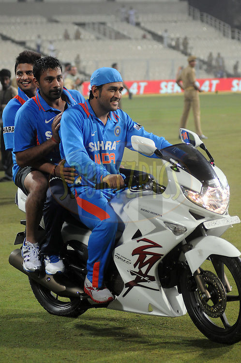 Mahendra Singh Dhoni captain of India, Praveen Kumar of India and Suresh Raina of India ride a bike. India win the series 5-0 India won the final and 5th One Day International ( ODI ) match between India and England by 75 runs, held at the Eden Gardens Stadium, Kolkata on the 23rd October 2011..Photo by Pal Pillai/BCCI/SPORTZPICS