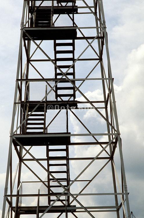 steel stairs in watchtower against sky