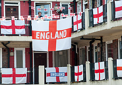 June 15, 2018 - London, London, United Kingdom - Kirby Estate. .View of the flags at the Kirby Estate...A south London housing estate has been adorned with 300 St George's flags in support ofEngland's World Cup bid..Red and white England flags cover every corner of Bermondsey's Kirby Estate, in Southwark, after patriotic residents banded to together to support England's efforts in Russia. (Credit Image: © Gustavo Valiente/i-Images via ZUMA Press)