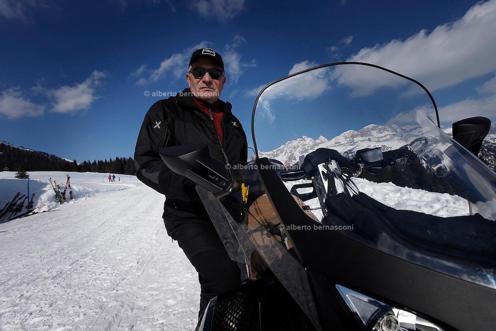 Italy, Madonna di Campiglio, Gino BRESADOLA, take tourists with his snowscooter to his refuge restaurant Malga Ritordo