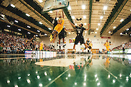 Catamounts guard Trae Bell-Haynes (2) leaps for a lay up during the men's basketball game between the Binghamton Bearcats and the Vermont Catamounts at Patrick Gym on Monday night January 19, 2015 in Burlington, Vermont. (BRIAN JENKINS, for the Free Press)