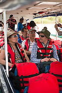 Costa Rica, February 2015. A high speed boat ride to Tortuguero. The Caribbean Coast is home to the beautiful town of Tortuguero and it's National Park. This sun drenched zone with its sparsely spaced coastal villages offers a completely laid back and relaxed atmosphere. The culture is vastly different on this coast compared to the rest of the country with its prominent Afro-Caribbean influence notable. Costa Rica is bestowed with an intense array of biodiversity and environmental attractions - majestic volcanoes, misty cloud forests, stunning river valleys, and hundreds of beaches along the Pacific and Caribbean coasts. Photo by Frits Meyst / MeystPhoto.com