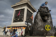 Environmental activists protest about Climate Change during an occupation of Trafalgar Square in central London, the second day of a two-week prolonged worldwide protest by members of Extinction Rebellion, on 8th October 2019, in London, England.