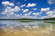 Cumulus cLouds reflected in Burnfield Lake<br /> Obatanga Lake Provincial Park<br /> Ontario<br /> Canada