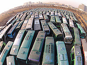 HANGZHOU, CHINA - DECEMBER 17: (CHINA OUT) <br /> <br /> One hundred junked public buses park at Douyunhe Villiage Parking Station on December 18, 2014 in Hangzhou, Zhejiang province of China. The junked public buses would be recollected by recycling companies firstly, then sent to Ningbo's Ministry of Public Security to be disassembled, and finally be back to steel plants for new usage. <br /> ©Exclusivepxi Media