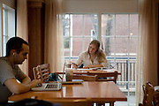 Students Daniel J. Hildebrand (Left) and Stefani Craze study in The Front Room in Baker Center.