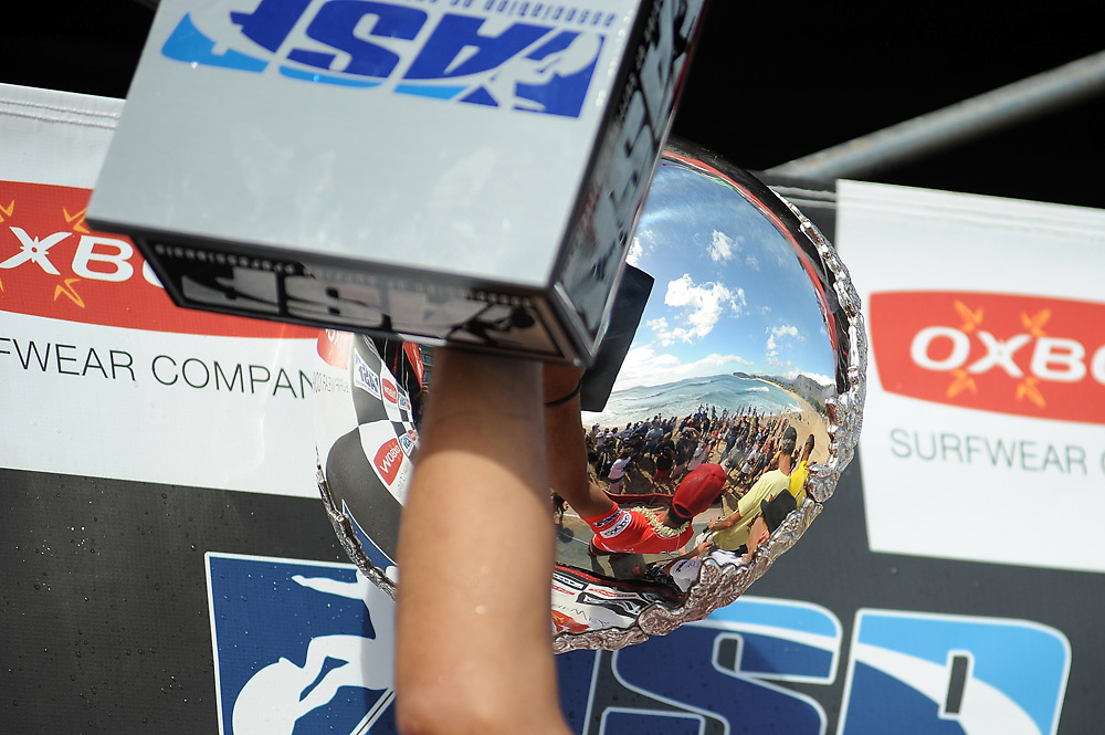 November 4th 2010: Reflection of the crowd on the beach through the ASP World Championship trophy during the final day of competition of the ASP World Longboard Championship at Makaha Oahu-Hawaii. Photo by Matt Roberts/mattrIMAGES.com.au