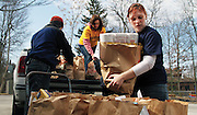 Students help unload groceries and other donated items during a food drive in the city of Kent. Students all over campus contribute their time to volunteer efforts in Kent and the surrounding communities.