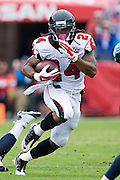 NASHVILLE, TN - OCTOBER 25:  Devonta Freeman #24 of the Atlanta Falcons runs the ball during a game against the Tennessee Titans at Nissan Stadium on October 25, 2015 in Nashville, Tennessee.  The Falcons defeated the Titans 10-7.  (Photo by Wesley Hitt/Getty Images) *** Local Caption *** Devonta Freeman