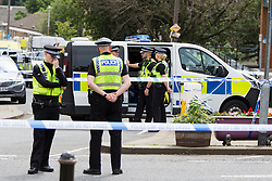 © Licensed to London News Pictures. 16/06/2016. Leeds, UK. Police at the scene in Birstall, south of Leeds, where Jo Cox, Member of Parliament for Batley and Spen, has been shot and stabbed during a constituency surgery. Photo credit: Andrew McCaren/LNP