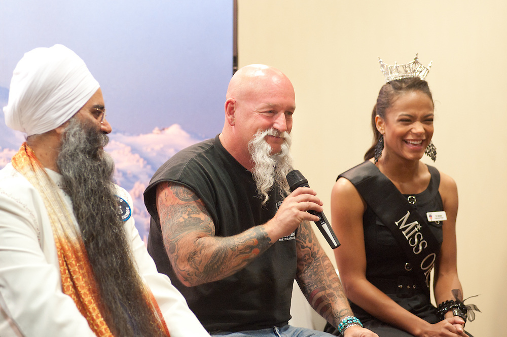 "Judges Sirwan Singh, left, Harry Lewis (from the fifth season of the television program ""Deadliest Catch"") and CC Barber, the current Miss Oregon, sit during a press conference in Bend, Oregon on Saturday, June 5, 2010 at the Beard Team USA National Beard and Mustache Championships. All three were among the judges for the event."