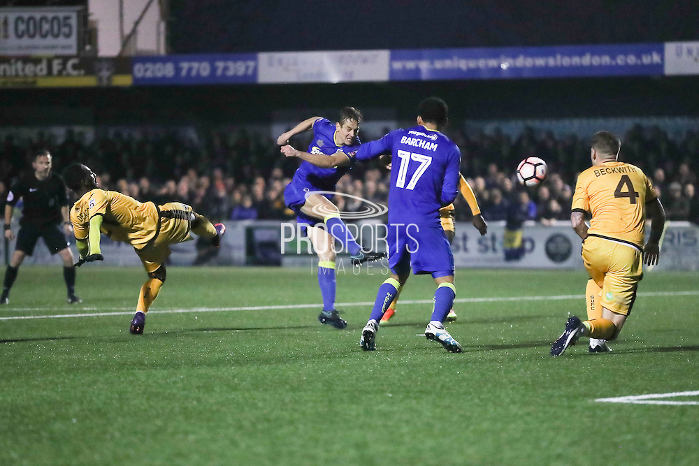 AFC Wimbledon defender Paul Robinson (6) shoots at goal during The FA Cup match between Sutton United and AFC Wimbledon at Gander Green Lane, Sutton, United Kingdom on 7 January 2017. Photo by Stuart Butcher.