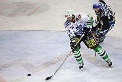 Nik Zupancic of ZM Olimpija and Daniel Oberkofler of Linz at ice hockey matchZM Olimpija vs Liwest Linz in second round of semi-final of Ebel League (Erste Bank Eishockey Liga),  on February 28, 2008 in Arena Tivoli, Ljubljana, Slovenia. Win of ZM Olimpija 3:2. (Photo by Vid Ponikvar / Sportal Images)