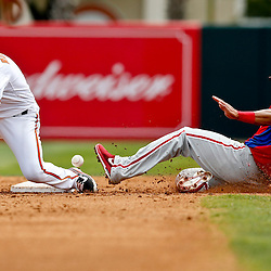 Mar 3, 2013; Sarasota, FL, USA; Philadelphia Phillies second baseman Cesar Hernandez (74) steals second base ahead of the throw to Baltimore Orioles second baseman Brian Roberts (1) during the top of the third inning of a spring training game at Ed Smith Stadium. Mandatory Credit: Derick E. Hingle-USA TODAY Sports