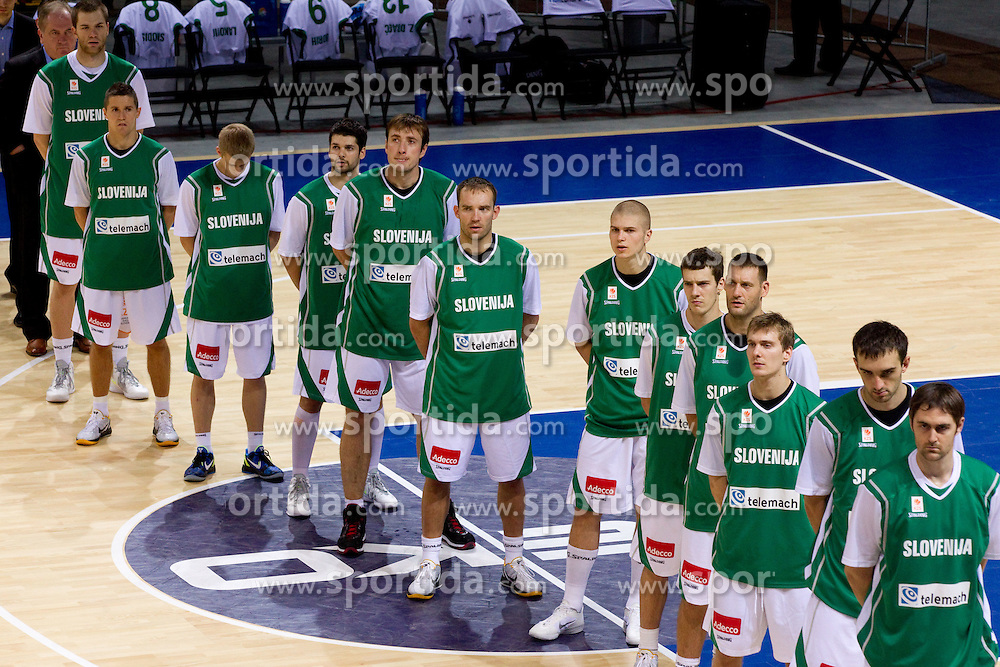 Bozidar Maljkovic, coach of Slovenia, Uros Slokar of Slovenia, Jaka Lakovic of Slovenia, Luka Rupnik of Slovenia, Saso Ozbolt of Slovenia, Matjaz Smodis of Slovenia, Samo Udrih of Slovenia, Edo Muric of Slovenia, Goran Dragic of Slovenia, Goran Jagodnik of Slovenia, Zoran Dragic of Slovenia, Mirza Begic of Slovenia and Erazem Lorbek of Slovenia listening to the national anthem during basketball match between National teams of Slovenia and Georgia in Group D of Preliminary Round of Eurobasket Lithuania 2011, on September 3, 2011, in Arena Svyturio, Klaipeda, Lithuania. Slovenia defeated Georgia 87-75. (Photo by Vid Ponikvar / Sportida)