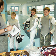 Greg Spahr talks to Gerrit Swart, 9, left, Emma Graf, 11, left-center, Jason Waldyke, 11, and Reaghan Juelke, 11, before a Cape Fear Fencing Association youth fencing tournament at Tileston Gym in Wilmington, N.C. Saturday May 31, 2014. (Jason A. Frizzelle)