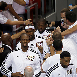 Jun 20, 2013; Miami, FL, USA; Miami Heat center Chris Bosh, LeBron James and Dwyane Wade enter the court prior to facing the San Antonio Spurs in game seven of the 2013 NBA Finals at American Airlines Arena. Mandatory Credit: Derick E. Hingle-USA TODAY Sports