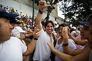 Venezuelan opposition's lider, Freddy Guevara (c) takes part in a campaign rally against Venezuelan President Hugo Chavez's proposal of constitutional changes in Caracas, February 7, 2009. Venezuelans will vote on February 15 on proposed changes to the constitution allowing Chavez and other politicians to stay in office as long as they keep winning elections. (Photo/Ivan Gonzalez)