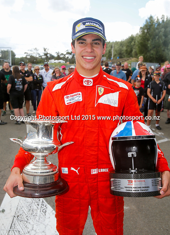Lance Stroll with the trophy for the New Zealand Grand Prix  and the Toyota Racing Series, Manfeild Motorsport Park, Feidling, New Zealand. Sunday, 15 February, 2015. Photo: John Cowpland / www.photosport.co.nz