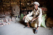 An artisans waits for power to be resotred at a workshop in Lahore. Parts of Pakistan are reportedly suffering 12-20-hours of electricity load shedding (power outages) per day. Many industries are suffering as a result of not being ale to use production machinery during load shedding and are unable meet deadlines for manufacture and delivery of goods.