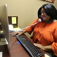 "Chris Jones, Founder of new nonprofit Sister S.O.A.R., take a phone call in her office. On April 14 Soster S.O.A.R will host an empowerment luncheon, ""Soaring into Transition"", at the Summit Center in Tupelo."