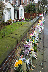 © Licensed to London News Pictures. 28/03/2018. Liverpool, UK. Rows of flowers and tributes left outside Ken Dodd's lifetime home in Knotty Ash on the morning of the funeral of comedian and performer Sir Ken Dodd , who died on 11th March 2018 at the age of 90 . Photo credit: Joel Goodman/LNP