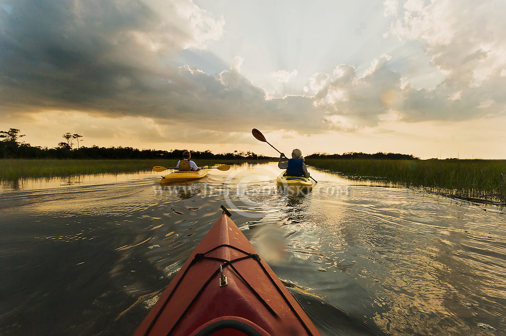 Kayakers enjoy a tour of Bald Head Island's back water at Sunset.