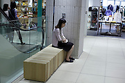 female sitting alone in a corner