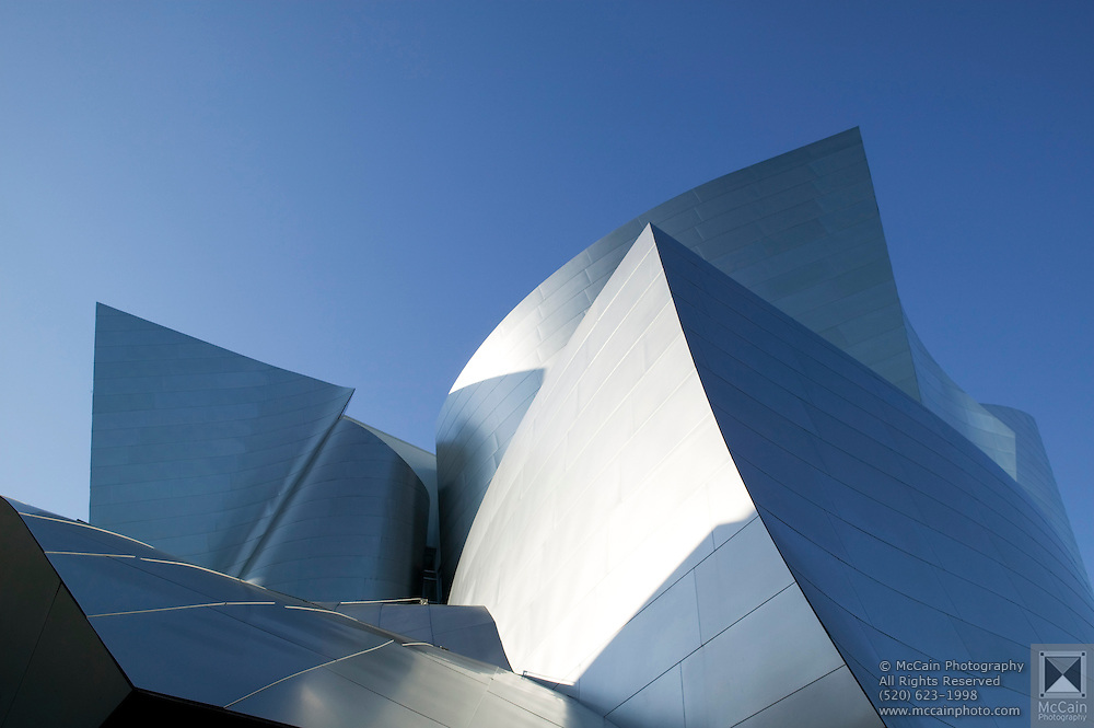 Sharp angles of Walt Disney Concert Hall with blue sky above, 135 North Grand Ave, Los Angeles, CA 90012, Part of Music Center, Performing Arts Center of Los Angeles County, California...Subject photograph(s) are copyright Edward McCain. All rights are reserved except those specifically granted by Edward McCain in writing prior to publication...McCain Photography.211 S 4th Avenue.Tucson, AZ 85701-2103.(520) 623-1998.mobile: (520) 990-0999.fax: (520) 623-1190.http://www.mccainphoto.com.edward@mccainphoto.com.
