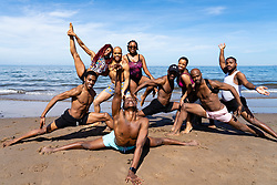 Portobello, Scotland, UK. 20 May 2020. Hot sunny weather brought out large crowds to Portobello beach today. Lockdown discipline seems to be a thing of the past with families and friends hitting the sand. A heavier than normal police presence had little visible effect since the public returned to the sand after the police walked away. Dancers from The Lion King UK Tour which was playing in Edinburgh before the lockdown have fun on the beach.  Iain Masterton/Alamy Live News